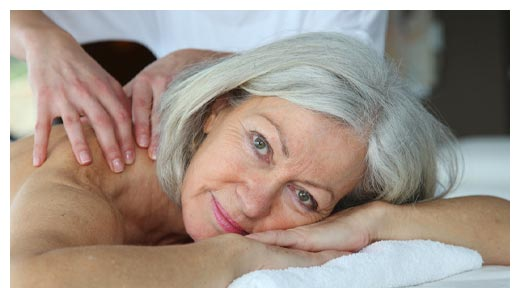 Chiropractic Asheville NC Older Woman Getting Massage